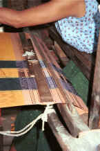 to Jpeg K Indigo thread being woven into a woman's longyi in a house in Amarapura, Shan State 9809e16.jpg