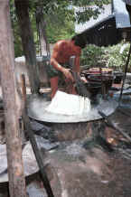 Jpeg 38K Plunging the fresh cotton hanks of thread into the steaming dye bath - Amarapura, Shan State 9809g04.jpg