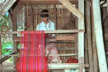 Jpeg 45 K 9809R06 Weaving Shan bags under a house off a waterway at the back of the floating market at Ywa-ma- Lake Inle, Shan State.