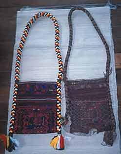 to Jpeg 50K This photo shows two bags: on the left is a new man's bag, Jinghpaw Hkahku, woven by Gwi Kai Nan in Myitkyina, 2002. This was commissioned by the Green Centre at the Brighton Museum (UK) which, in 2001, commissioned weavers in Kachin State to make 17 wedding outfits. The bag on the right has been in Gwi Kai Nan's family for more than four generations.