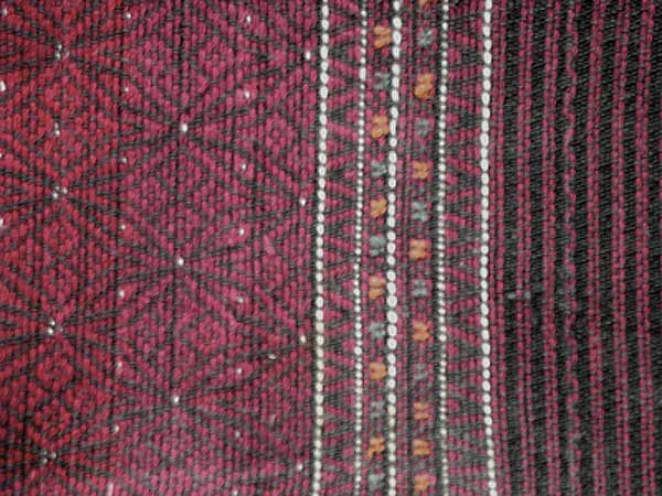 Jpeg 54K Khumi woman's tubeskirt - detail showing the black warp and red, white and black supplementary weft patterning