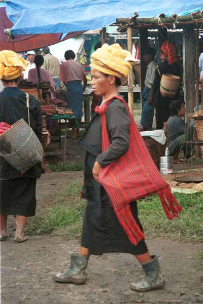 31K Jpeg 9809M36 Pa'O woman striding through Nampan 5-day rotating market, Lake Inle, Shan State