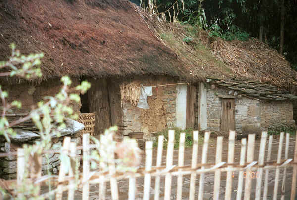 Thatched roof, stone walled house in Chang Tion village, Cheng Guan township, Puding county, Guizhou province 0010v33.jpg