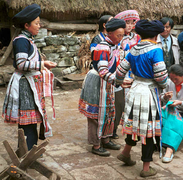 Miao women gathered outside houses showing off their embroidery skills - Chang Tion village, Cheng Guan township, Puding county, Guizhou province 0010w16.jpg