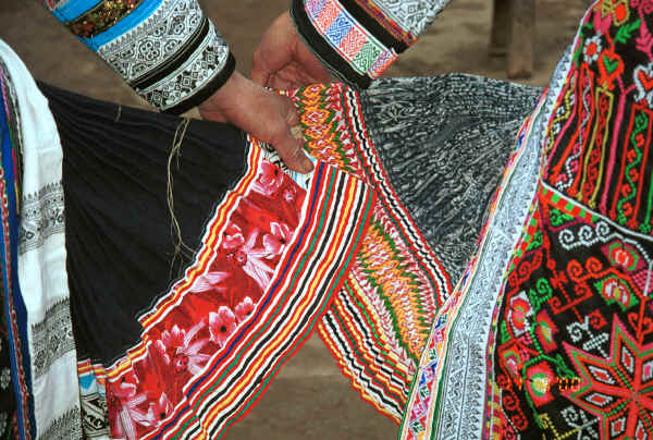 Miao women comparing their skirts - the black skirt on the left is hemp and the one on the right is ramie - Chang Tion village, Cheng Guan township, Puding county, Guizhou province 0010w17.jpg