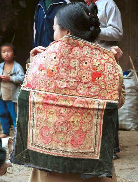 Miao baby embroidered baby carrier being show (looks Side Comb Miao in style) - Chang Tion village, Cheng Guan township, Puding county, Guizhou province 0010w29.jpg