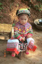 Jpeg 104K Little girl all dressed up in her festival finery although she was too young to dance - Da Shu Jia village, Xin Zhou township, Longlin county, Guangxi province 0010i04.jpg