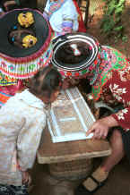 Jpeg 67K Focusing on developing the batik design - We saw some very fine batik work in this village - Da Shu Jia village, Xin Zhou township, Longlin county, Guangxi province 0010i08.jpg