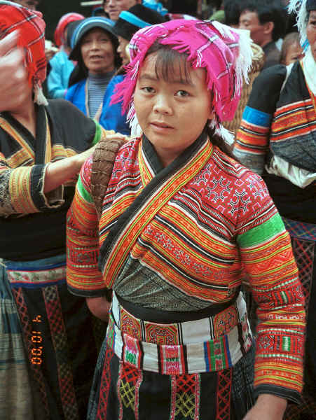 Flower Miao woman from a village in Zhu Chang township bringing her textiles to sell in De Wo market, De Wo township, Longlin county, Guangxi province, South West China 0010f29.jpg