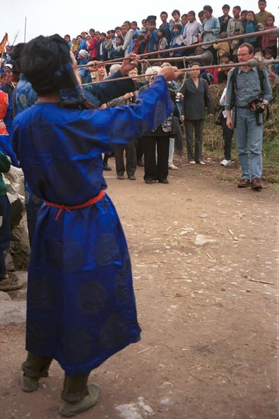 Jpeg 49K  0110D27 Long trumpets being blown as part of our welcome to Gan He village, Ya Rong township, Huishui county, Guizhou province, south-west China. The people living in this village are known as Qing Miao.