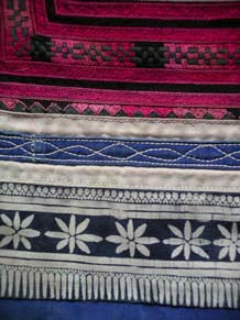 to Jpeg 55K MGP1302e  Detail of the bottom of an embroidered Ge Jia baby carrier collected by Pamela Cross in 2001 in Ma Tang village, Kaili city and which Andrew Dudley estimates is likely to be more than 20 years old. See his embroidered baby carrier which the seller estimated as between 30-40 years old.