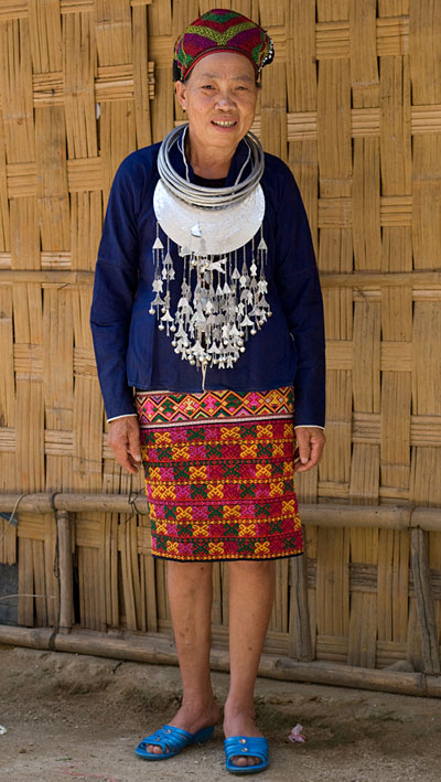 Huang Ji Xiang, a member of the Qi subgroup of the Li people, wearing her festival outfit, including a skirt decorated with the technique shown in the other photos and described by Chris who thinks that it was made by her in the 1980s-90s.