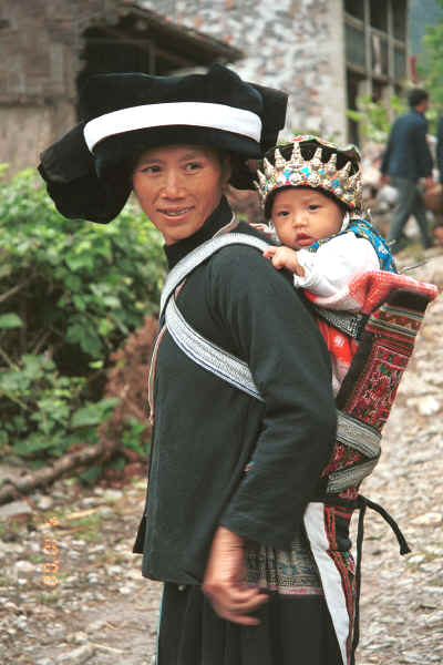 Side comb Miao woman and baby in their festival finery, Long Dong village, De Wo township, Longlin country, Guangxi province 0010d33.jpg