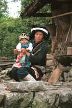 Jpeg 35K Side comb Miao woman and baby in their festival finery, Long Dong village, De Wo township, Longlin country, Guangxi province 0010e09.jpg