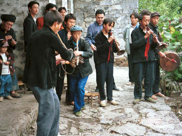 Side comb Miao musicians performing for us during our visit to Long Dong village, De Wo township, Longlin country, Guangxi province 0010f07.jpg