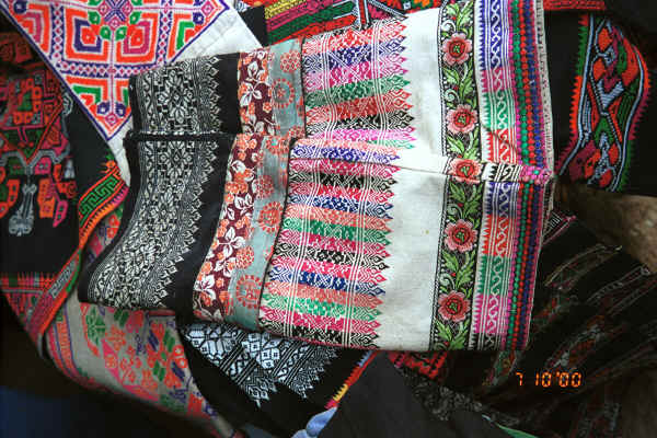 Finely embroidered separate sleeves lying over an embroidered apron - Sha Jiao village, Wan Teng township, Xingyi metropolitan area, Guizhou province 0010m06.jpg