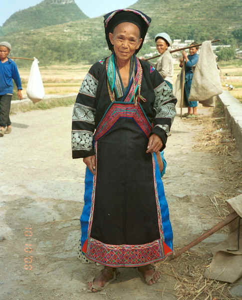 Old Bouyei textile seller modelling the jacket which I had just bought - Shitou village, Huanggousu township, Zhen Nin county, Guizhou province 0010u10.jpg
