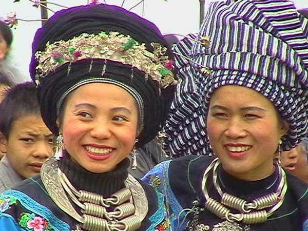 57K Jpeg Miao girls in woven turbans and heavy silver jewlry at a festival in a village in Songtao Miao Autonomous County, Tongren Prefecture, eastern Guizhou Province.