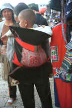 Jpeg 24K Sani baby in a traditional embroidered baby carrier - Stone Forest, Shilin, Stone Forest county, Yunnan province 0010b05.jpg