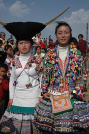 to Jpeg 67K White Miao girls in festival dress at the White Miao Dance Flower festival near Dafang in April 2007