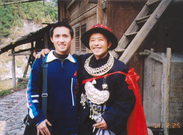 Jpeg 53K E16e Tony Chen with the Shaman on 25 February 2004, the fourth day of the festival, when the spirit of the Mountain Dragon was taken into each house in the village by the Shaman and the leading men of Langde village, Guizhou province