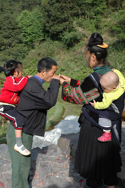 72K Jpg image Tony's aunt, wearing festival clothes, offering rice wine to his elder sister's father-in law