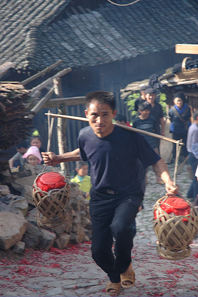 69K Jpg image The rice wine given by Tony's older sister being carried up to the village