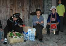 to 63K Jpg image Female villagers giving a little money, rice, eggs and so on. They receive steamed sticky rice and a meal.