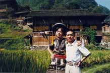 Jpeg 50 K Tony Chen Hualong with a former colleague against the background of Tony's house and fertile paddy fields