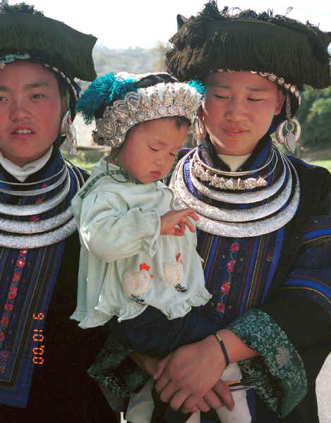 Black Miao young women with baby all in their festival finery, Zuo Qi village, Min Gu township, Zhenfeng county, Guizhou province 0010q22.jpg