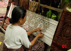 to 76K Jpg - tying ikat with palm frond in Sikka village
