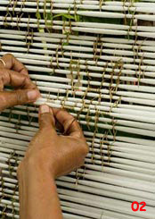 to 89K Jpg - tying ikat with palm frond in Sikka village