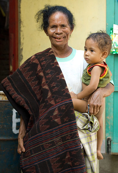 Theorara Gelu with a young relative and the sarong she dyed and wove herself, with a manta ray motif. Handspun cotton and natural dyes. Lamalera