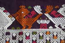 to Jpeg 52K A new (end 20th beginning 21st century) woven fragment showing an ancestor figure between two bird riding on the back of a siho, a mythological animal half-lion, half-elephant unique to the Lao culture and considered to be imbued with special powers.