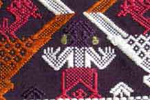 to Jpeg 51K A new (end 20th beginning 21st century) woven fragment showing an ancestor figure. Woven in cotton, probably chemical dyed supplementary weft coloured threads.