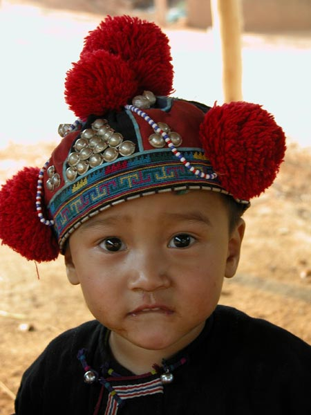 Jpeg 40K Young Yao boy wearing a traditional style protective hat in a village near Chiang Rai  3240