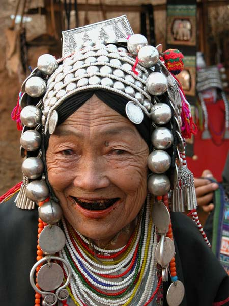 Jpeg 54K Old Loimi-Akha woman in a village near Chiang Rai with her teeth stained by chewing betel nut. 3248