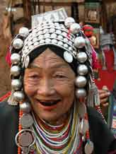 to Jpeg 54K Old Loimi-Akha woman in a village near Chiang Rai with her teeth stained by chewing betel nut. 3248