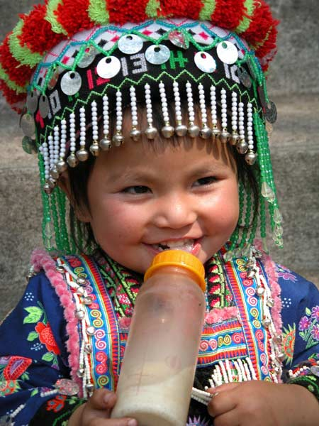 Jpeg 56K Young White Hmong girl in her festival finery  3311