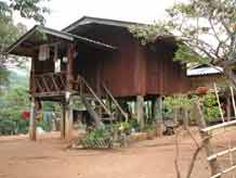 to Jpeg 59K A house in a Karen village on Doi Inthanon, the highest peak of Thailand 3373