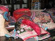 to Jpeg 57K A pile of tribal textile goodies in Kesorn and Bucklee Bell's gallery 'Kesorn Arts' in Chiang Mai 3395