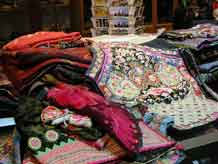 to Jpeg 63K A pile of tribal textile goodies in Kesorn and Bucklee Bell's gallery 'Kesorn Arts' in Chiang Mai 3400