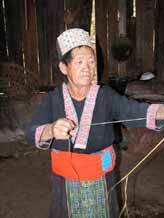 to Jpeg 56K An old White Hmong woman stripping hemp from under the bark in the village of Ban Pha-nok-kok 3425