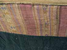 "to Jpeg 66K Detail of supplementary weft top band of a Tai Daeng Mosquito Net (pha mung) from Xam Tai in northeast Laos. Approximately: 61"" x 65"" on the sides and 60"" high; hanging pockets extends 4"" from main 'box'. Four panels on each side of handspun, handwoven indigo cotton, with silk and cotton heading border in good condition; top of four panels (one is pieced making three parts) gold-colored handspun, handwoven cotton. One side (side 'd') has a panel replaced, or of darker color indigo. Several patches and some holes, although none are larger than 1"". A few patches of supplementary warp scraps. All handstitched. Early 20th century."