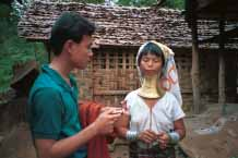 Jpeg 54K Thai guide offering anti-malaria tablets to Padaung woman 8812j02