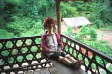 Jpeg 45K Padaung woman sitting in the verandah of her house 8812J04A