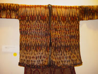 to 65K Jpg 22 - Detail 1 of Bla'an (possibly T'boli) man's abaka and ikat jacket and trousers, Mindanao, early 20th century. Jacket 152 cm x 56 cm x 52 cm. Trousers 56 cm x 44 cm