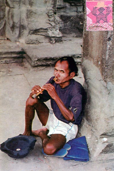 ss21 Jpeg 55K Another photo I took in Ankor Wat in 1996.  He does not appear so friendly on second viewing!