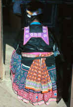 to Jpeg 35K Back view of a Blue Hmong woman showing collar, sash and skirt 881200a