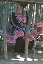 to Jpeg 36K Blue Hmong woman dressed in all her finery in a village on Doi Suthep above Chiang Mai 8812l05